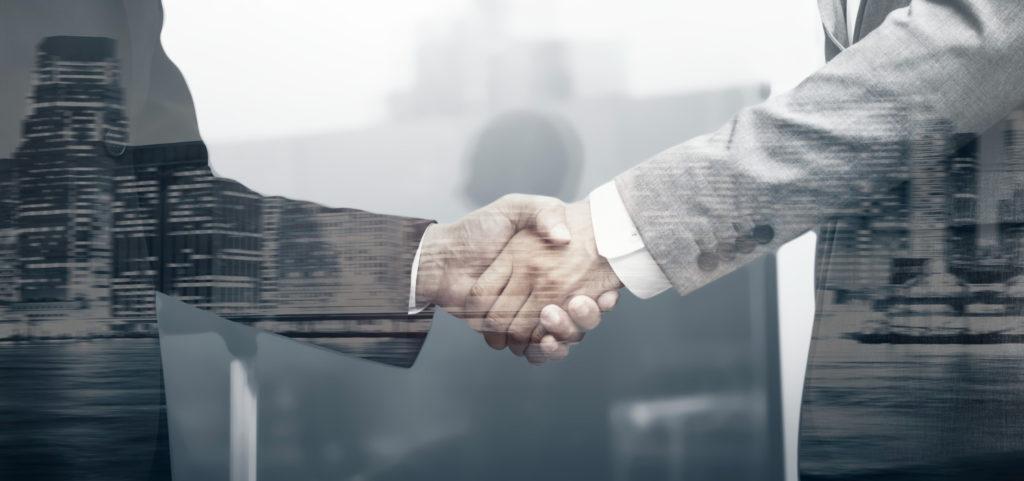 Business Partners Handshake International Business Concept E1633717510473